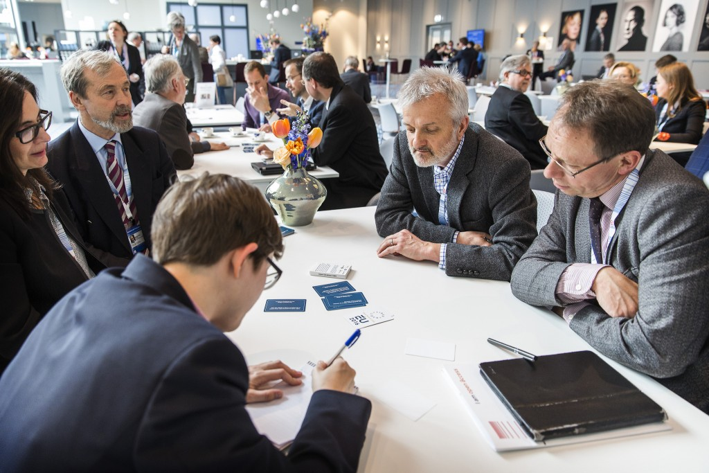 Some very recognisable conference delegates discussing TDM at the FutureTDM Open Science cafe. Image CC BY NL2016EU